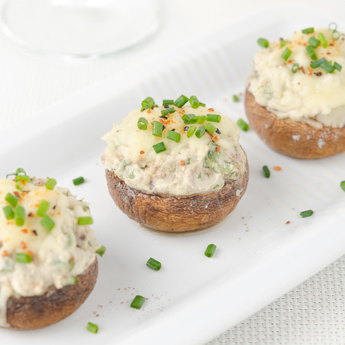 Stuffed mushrooms, baked with cheese and herbs,