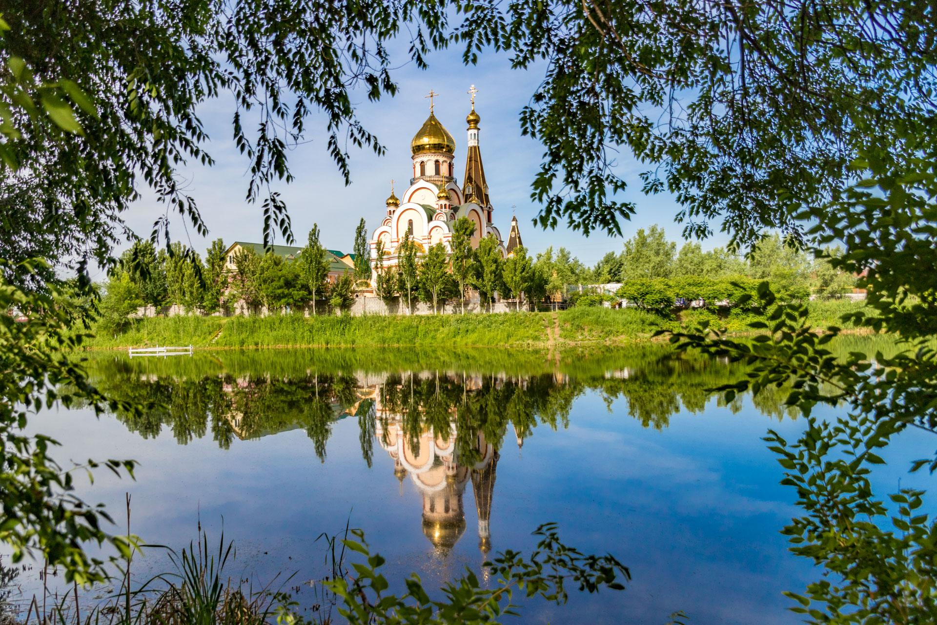 Almaty, Kazakhstan - quaint church with tree frame